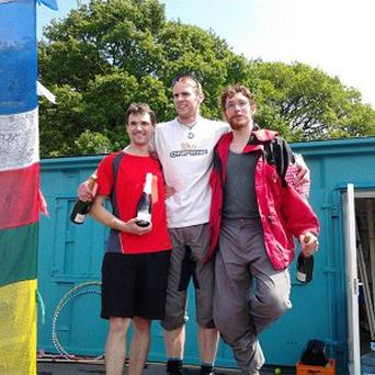 Unicyclists, including from left, Stephen Devereux, Paul Stacey and Ross Atkins, set a new world record by pedalling more than 1,700 miles in 24 hours