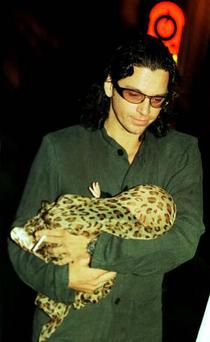 Michael Hutchence holds his daughter, Tiger Lily.