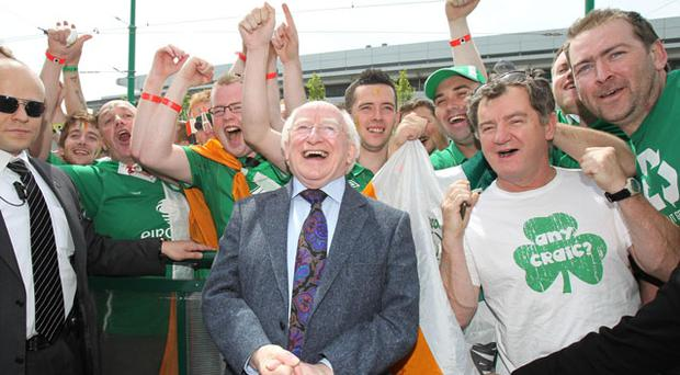 President Michael D Higgins has urged Irish fans to keep singing despite the devastating opening to the Euro 2012 campaign.