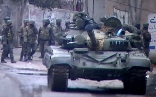 A Syrian army checkpoint in the restive Damascus suburb of Saqba Photo: AFP/Getty Images