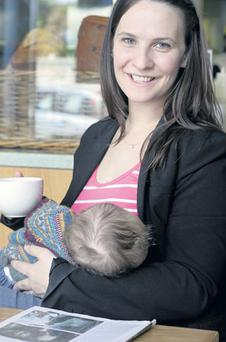 Out in public: Mary-Elaine Tynan breastfeeds her baby in a Dublin cafe.