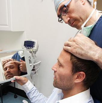Michael Gray has said he hopes the hair transplant will boost his confidence
