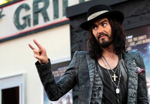 Cast member Russell Brand gestures at the premiere of