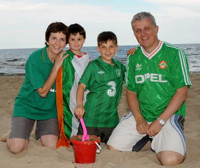 Irish fans John O'Mahoney, from Kildare, with wife Eileen, from Kerry, with sons Jackson, 8, and Conor, 4, pictured on the beach in Sopot