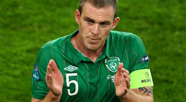 Richard Dunne walks off dejected during the UEFA EURO 2012 group C between Ireland and Croatia