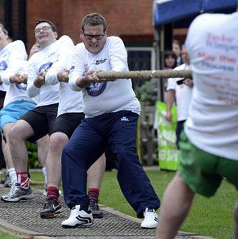 A team made up of MPs takes part in the Parliamentary Tug of War in aid of the Macmillan Cancer Support charity