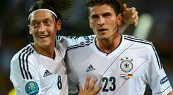 Germany's Mario Gomez (R) celebrates with Mesut Oezil scoring his second goal against Netherlands. Photo: Reuters