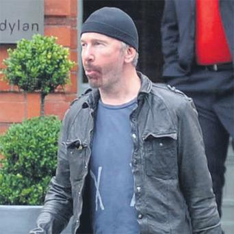 The Edge leaves the Dylan Hotel in Dublin yesterday after the death of his mum Gwenda Evans