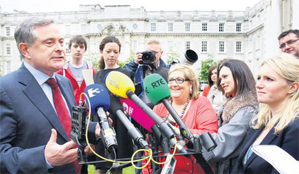 Minister for Public Expenditure and Reform Brendan Howlin speaks to the media following the publication of the Second Progress Report on the Croke Park Public Service Agreement at Government Buildings yesterday