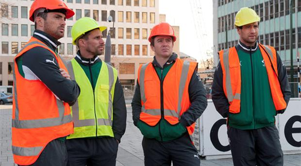 Members of the Ireland Rugby team, from left, Rob Kearney, Jason Cowman, Strength & Conditioning Coach, Eoin Reddan and Kevin McLaughlin, visit Cathedral Square, in the damaged Red Zone in Christchurch. Photo: Sportsfile