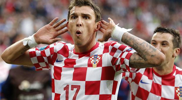 Croatia's Mario Mandzukic celebrates after equalising for Croatia. Photo: AP