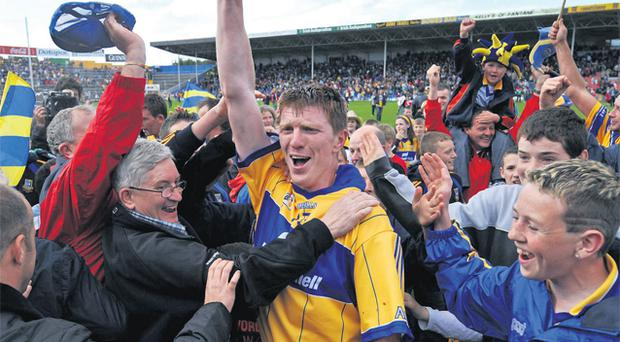 Niall Gilligan celebrates with Clare supporters after beating Limerick at Semple Stadium in 2008