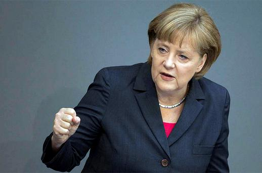 German Chancellor Angela Merkel delivers a government statement on her policy plans for the upcoming Mexico G-20 summit at the Bundestag. Photo: Reuters