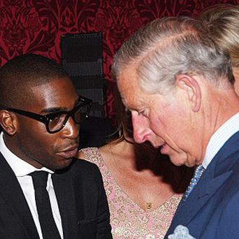 The Prince of Wales listens to rapper Tinie Tempah during a reception at St James Palace, London, to launch the London Collections: Men