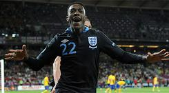 Danny Welbeck celebrates after scoring England's winner