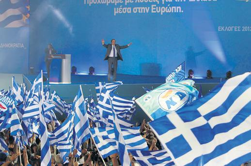 Conservative New Democracy party leader Antonis Samaras waves to supporters during a preelection rally at Syntagma square in Athens yesterday. Greece faces a stark choice between sticking with the euro or returning to the drachma in a knife-edge election this weekend