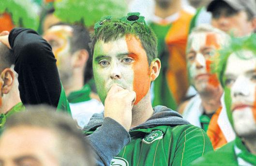 A supporter watches in dismay during the final moments of Ireland v Spain last Thursday.