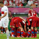 Poland's Dariusz Dudka (L) walks by as Czech Republic's players congratulate Petr Jiracek (on ground) after he scored a goal. Photo: Reuters