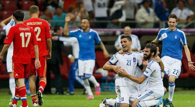 Greece's players celebrate victory against Russia. Photo: Reuters