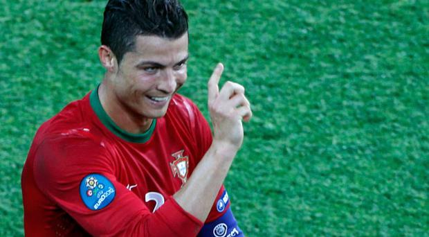 Portugal's Cristiano Ronaldo celebrates after scoring his second goal against Netherlands.Photo: Reuters