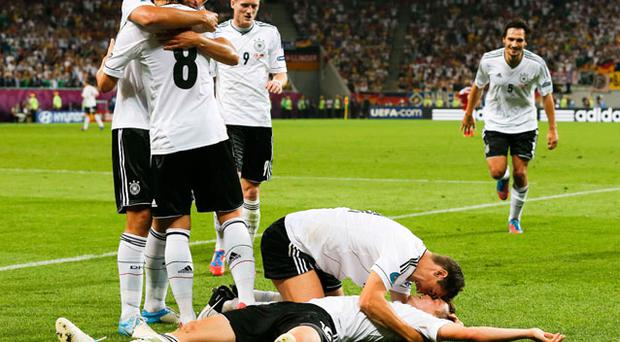 Germany's Miroslav Klose embraces Lars Bender (bottom) as they celebrate after scoring a goal against Denmark. Photo: Reuters