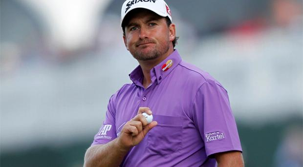 Graeme McDowell reacts after holing out on the 17th hole during the third round of the 2012 US Open. Photo: Reuters