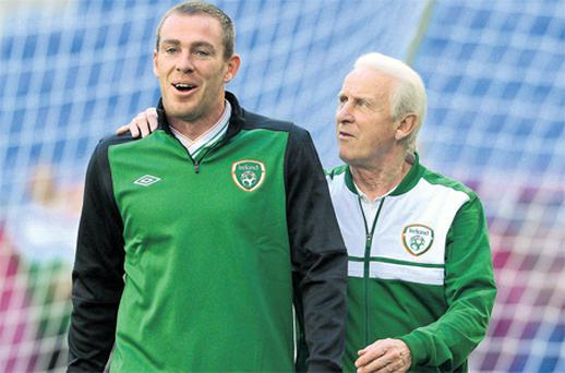 Ireland manager Giovanni Trapattoni speaks with Richard Dunne during training in Poznan last night