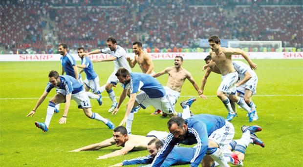 Greece players celebrate their victory against Russia which secured an unlikely quarter-final place