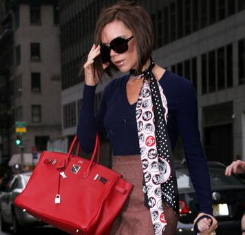Victoria beckham with one of her reported 100 Hermes bags