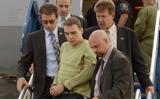 Luka Rocco Magnotta returns to Canada via military transport plane from Germany, where he was arrested this month. Photo: AP