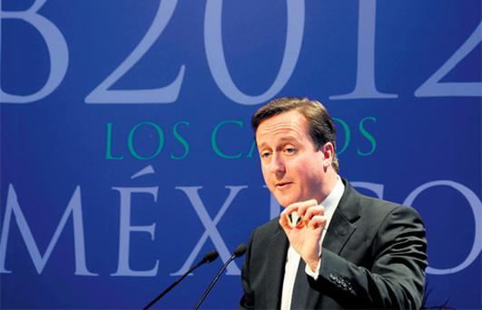 UK Prime Minister David Cameron speaks to business leaders at the B20 business summit yesterday in Los Cabos, Mexico.