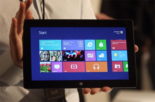 A Microsoft representative holds a new Surface tablet
