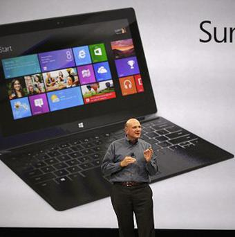 Microsoft CEO Steve Ballmer unveils new tablet computer Surface (AP/Damian Dovarganes)