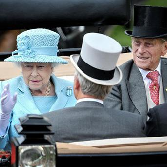 The Queen arrives with the Duke of Edinburgh during day one of the 2012 Royal Ascot meeting
