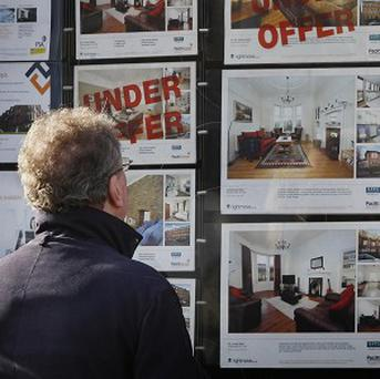 An out-of-court settlement structure is needed to help in-debt mortgage holders, says human rights group