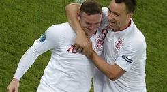 Wayne Rooney celebrates his goal against Ukraine with team mate John Terry. Photo: Reuters