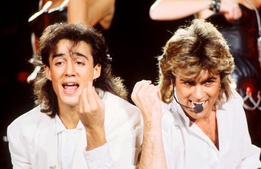 Andrew Ridgeley and George Michael of Wham! perform on stage at Sydney Entertainment Centre, Sydney, Australia, 27th January 1985. (Photo by Michael Putland/Getty Images)