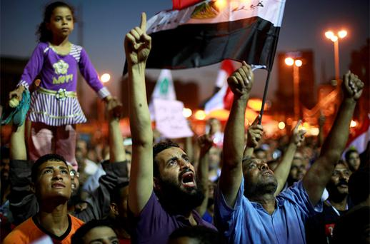 Supporters of the Muslim Brotherhood's presidential candidate Morsy shout during a rally at Tahrir square in Cairo. Photo: Reuters