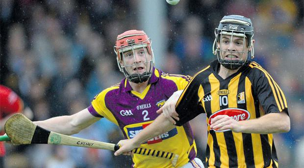 Kilkenny's Cathal Kenny tries to get away from Willie Deveraux during the Bord Gáis Energy Leinster U-21 Hurling Championship semi-final at Nowlan Park