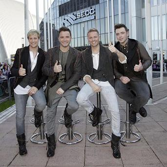 Westlife stars Kian Egan, Shane Filan, Nicky Byrne and Mark Feehily sitting on bar stools engraved with their names