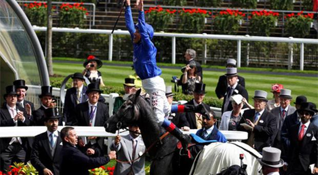 Frankie Dettori on Colour Vision celebrates after winning The Gold Cup