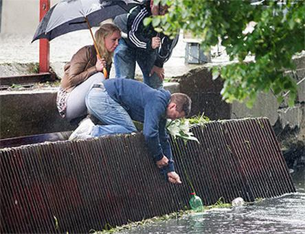 Andrew Nolan, heartbroken brother of James, was accompanied by his partner Sophie Dennison and brother-in-law Gareth Dudley when he brought flowers to the spot where James's body was found in the river in Bydgoszcz, Poland