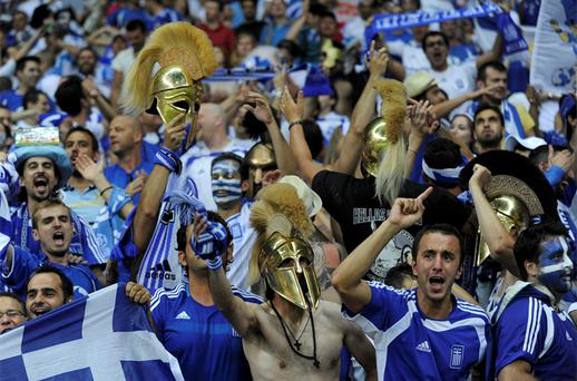 Greece's fans celebrate after their team scored a goal against Russia. Photo: Reuters