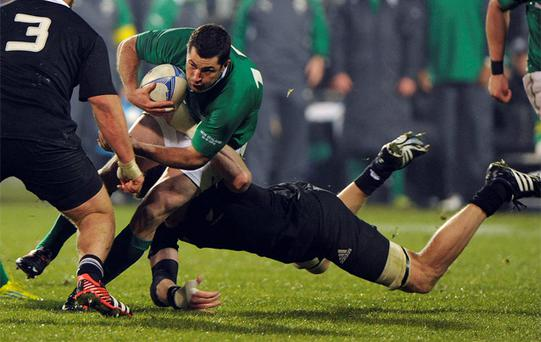Rob Kearney tackled by New Zealand All Blacks' Adam Thomson during their rugby test match in Christchurch. Photo: Reuters