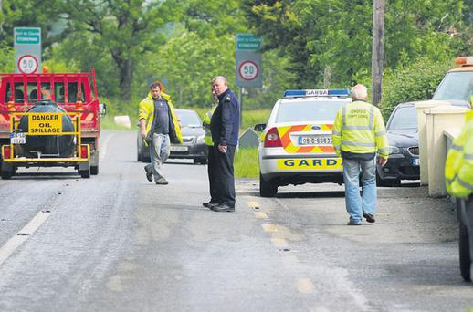 Gardai at the scene on the outskirts of Longford, where two male passengers died in car crash yesterday
