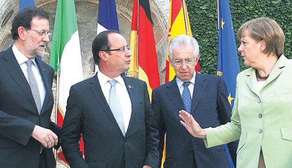 (L-R) Spanish Prime Minister Mariano Rajoy, French President Francois Hollande, Italian Prime Minister Mario Monti and German Chancellor Angela Merkel. The leaders of Germany, Italy, Spain and France met in Italy's capital to form a consensus on the handling of Europe's financial crisis ahead of next week's summit of European Union leaders