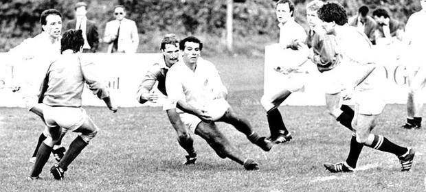 Chasing pack: Star player Tony Ward (centre) in action
