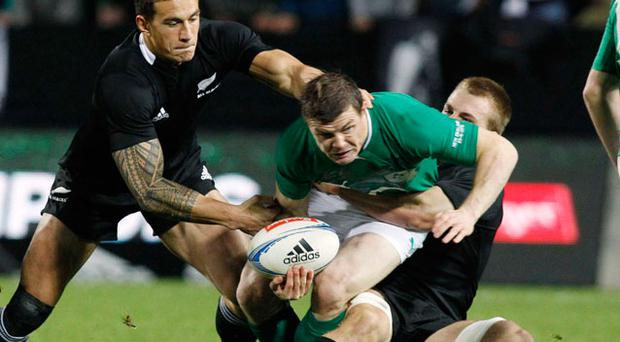 Ireland's Brian O'Driscoll (C) is tackled by New Zealand All Blacks' Sonny Bill Williams (L) and Sam Cane during their international rugby test match. Photo: Reuters