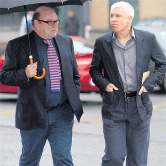 U2 manager Paul McGuinness and Adam Clayton arriving at court last week