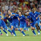Italy players celebrate their penalty shoot-out victory over England. Photo: Reuters